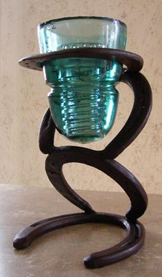 Horseshoe and glass insulator Candleholder